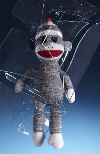 Sock Monkey Crashing Through a Pane of Glass - Stop Action